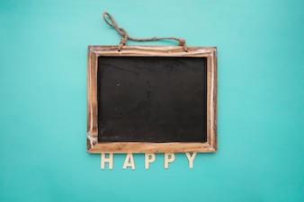 Tafel mit glücklichen Schriftzug