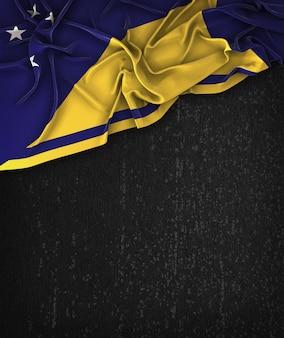 Tokelau-Flagge Vintag auf einem Grunge-Schwarz-Tafel mit Platz für Text