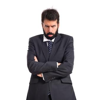 Trauriger Geschäftsmann über weißem Hintergrund