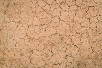 Trockene und rissige Boden Textur.