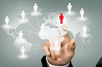 Unternehmer, die eine rote Symbol berühren verbunden