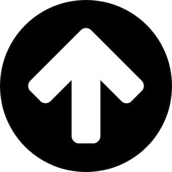 黒丸の背景上に矢印