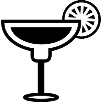 Cocktail glass with lemon slice on the border