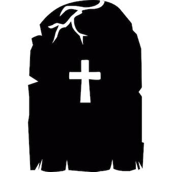 Cross on a creepy headstone for Halloween