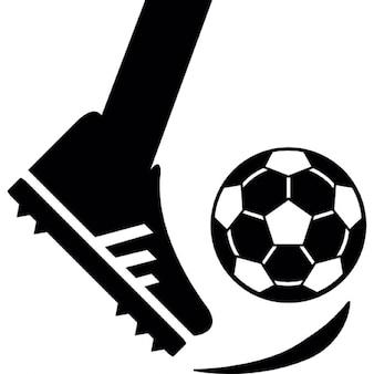 Feet kicking a soccer ball