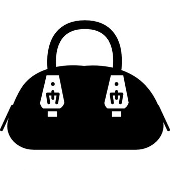 Female hand bag with metal handle tips