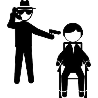 Gangster talking by a phone and pointing with an arm to a prisoner sitting on a chair in front of him