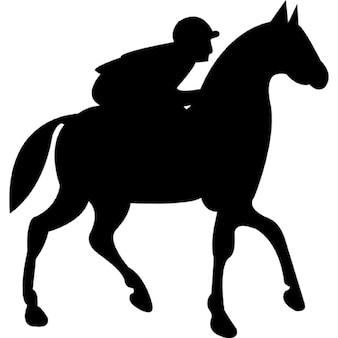 Jockey riding on black walking horse