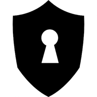 Keyhole in a shield black shape
