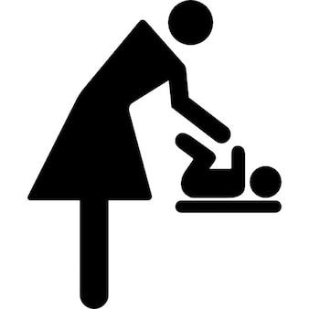 Mother changing baby clothes