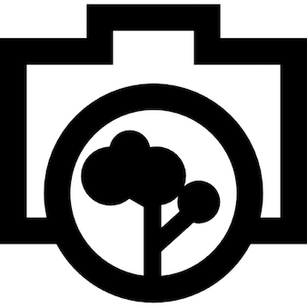 Photo camera outline with a tree objective