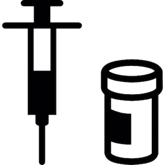 Syringe with medication beside drug container