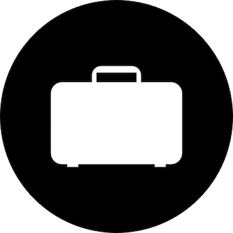 Travel luggage inside a black circle background