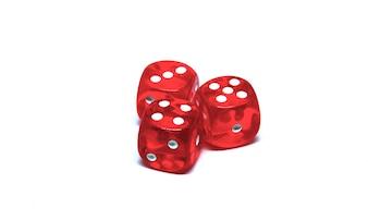 3 red dice close up