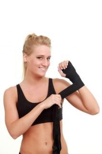 Woman wrapping her hands for a wrestling