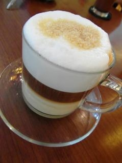 layered latte in glass cup