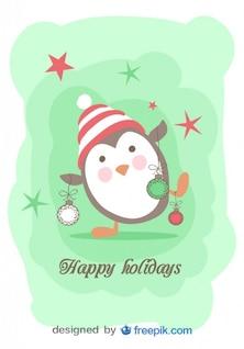 Penguin holding Christmas Balls