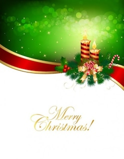 Christmas candle on green background