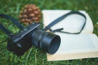 A book and a camera in the park