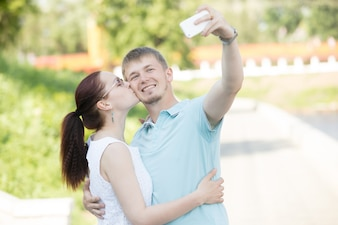 A couple making selfie in park