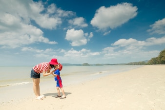 A mother and son on beach outdoors Sea and Blue sky