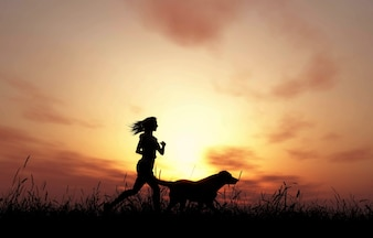 A woman running next to a dog on a sunset