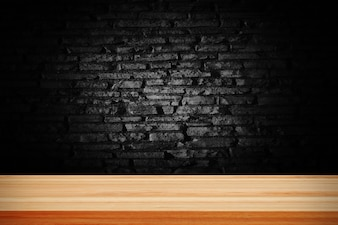 Abstract black grunge brick and wooden table deck.