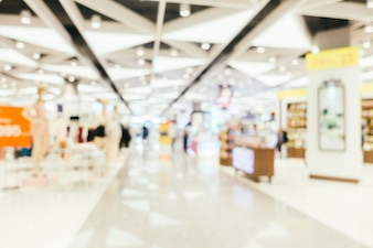 Abstract blur and bokeh defocused shopping mall interior of department store
