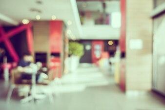 抽象的なぼかしコーヒーショップとレストランのインテリア