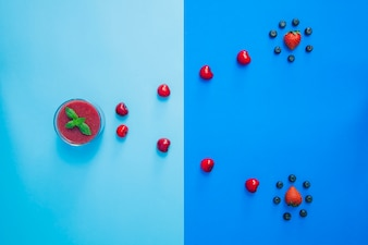 Abstract composition with red fruits