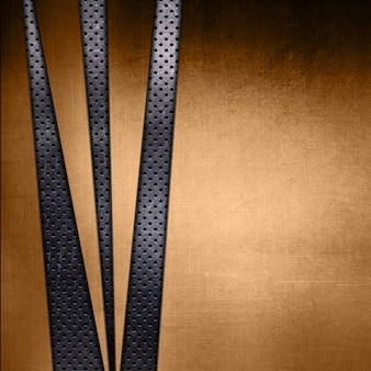 Abstract gold metal texture on a perforated metallic background