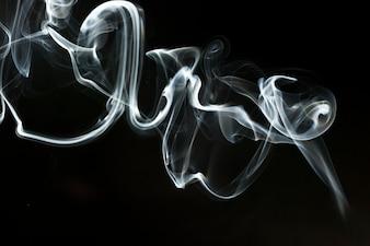Abstract smoke shape on dark background
