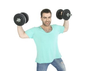 Active man with dumbbells and jeans