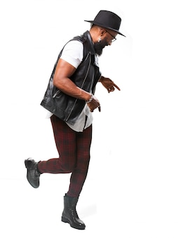 Active man with hat dancing