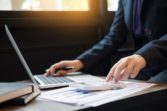 Administrator business man financial inspector and secretary making report, calculating balance. Internal Revenue Service checking document. Audit concept.