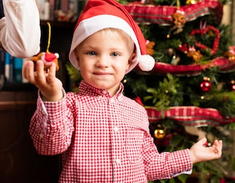 Adorable child holding a christmas ornament