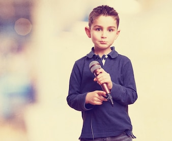 Adorable child holding a microphone