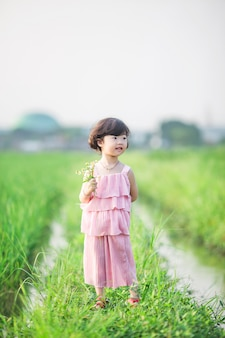 Adorable little girl with flowers in hand