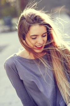 Adorable teen laughing with closed eyes