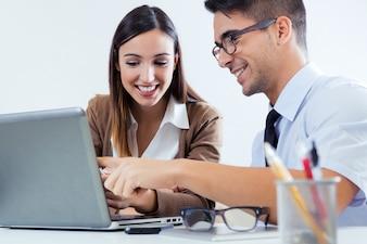 Adult handsome smiling businesspeople together