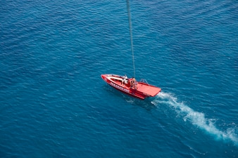 Aerial view of red speedboat