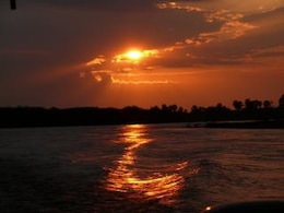 African sunset on river, clouds