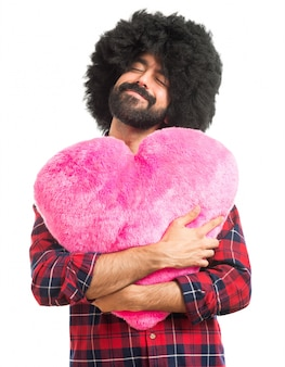Afro man holding a big heart