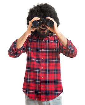 Afro with binoculars