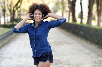 Afro woman fun music young