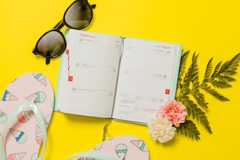 Agenda with sunglasses and flip-flops