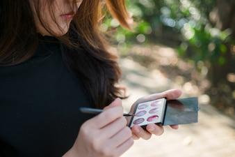 Aisian woman using cosmetic