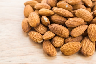 Almond on wooden background