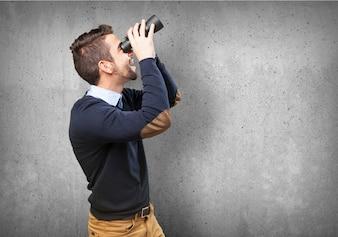 Amazed boy using his binoculars