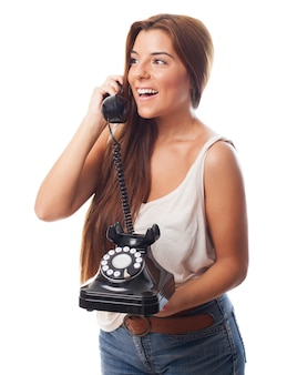 Amazed girl with rotary phone